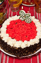 Birthday cake for twenty five year old a tasty red topping a Stock Image
