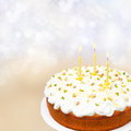 Birthday cake with yogurt icing candles on colored background delicious and a bokeh Stock Photography