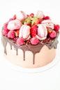 Birthday chocolate cake with strawberries, raspberries and macarons
