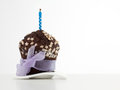 Birthday chocolate muffin with candle on top Stock Photo