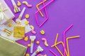 Birthday concept with gifts, greeting cards and party whistles on violet background top view copyspace