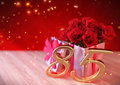Birthday concept with red roses in gift on wooden desk. eightyfifth. 85th. 3D render