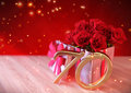 Birthday concept with red roses in the gift on wooden desk. seventieth. 70th. 3D render