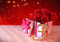 Birthday concept with red roses in gift on wooden desk. third. 3rd. 3D render