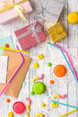 Birthday concept with wrapped gifts, greeting cards and sweets on grey wooden background top view