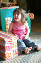 Birthday crying girl opening presents Arkivfoton