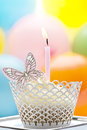 Birthday cupcake with candle and butterfly a decorated a cream a Stock Photography