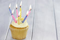 Birthday cupcake with eight burning candles and copy space Stock Photo