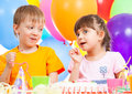 Birthday of cute kids twins Royalty Free Stock Photo