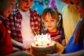 Birthday dessert group of adorable kids looking at cake with candles Royalty Free Stock Images
