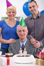 Birthday with family senior men celebrating his th Royalty Free Stock Photos