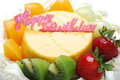 Birthday fruit cake on white background Royalty Free Stock Image