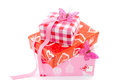 Birthday gift three gifts wrapped in red and pink wrapping paper and pink ribbon and butterfly Stock Photography