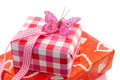 Birthday gifts three wrapped in red and pink wrapping paper and pink ribbon and butterfly Stock Photo