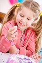 Birthday girl takes a sneak taste of frosting extensive series about young girls at colorful party Stock Photography