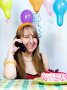 Birthday. Happy pretty girl with phone Royalty Free Stock Image