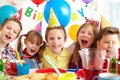 Birthday joy group of adorable kids looking at camera at party Royalty Free Stock Photo