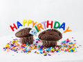 Birthday muffins chocolate with candles that spell happy Royalty Free Stock Photos