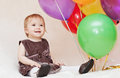 Birthday one year old girl with balloons on a white background Stock Images