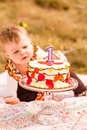 Birthday party baby girl celebrating her first bithday with gourmet cake and balloons Stock Images