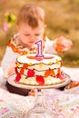 Birthday party baby girl celebrating her first bithday with gourmet cake and balloons Royalty Free Stock Photo