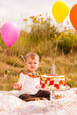 Birthday party baby girl celebrating her first bithday with gourmet cake and balloons Royalty Free Stock Image