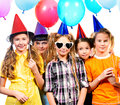 Birthday party group of happy kids having fun at a isolated over white Stock Photo