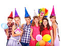 Birthday party group of teen with clown people isolated Royalty Free Stock Images
