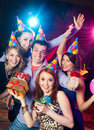 Birthday party at nightclub cheerful young company celebrates in a Stock Photography