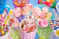Birthday party table with marshmallow pops and other sweets for Royalty Free Stock Photo