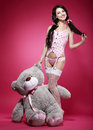 Birthday playful young enticing woman holding her happy funny with gift big teddy bear Stock Images