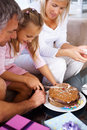 Birthday - Young girl cutting cake with parents Royalty Free Stock Photography