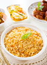 Biryani rice or briyani rice curry chicken and salad traditional indian food on dining table Stock Photos