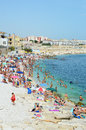 BISCEGLIE, ITALY - AUGUST 3, 2017: Very Crowded Beach Full Of People At The Mediterranean Sea in Apulia turist region, Bisceglie Royalty Free Stock Photo