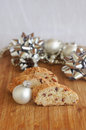 Biscotti with almond and cranberry with silver christmas toy on wooden background with silver bows on background Stock Photography