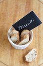 Biscotti with almond and cranberry in white plate with chalk board inscription on wooden background Stock Images