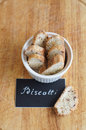 Biscotti with almond and cranberry in white plate with chalk board inscription on wooden background Stock Photography