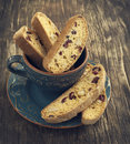 Biscotti with cranberry and walnuts on wooden background Stock Photo