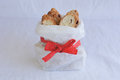 Biscotti in paper bag with red bow cookies almond and cranberry white Royalty Free Stock Image