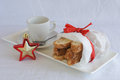 Biscotti in white paper bag on plate with coffee cup almond and cranberry red bow and spoon Royalty Free Stock Images