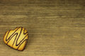 Biscuit with chocolate icing on wooden background Royalty Free Stock Images
