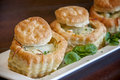 Biscuit cups this is a of filled with stuff garnished with spinach they are filled with a spinach dip then cheese Royalty Free Stock Images