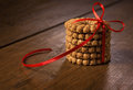 The biscuits with red ribbon on table Royalty Free Stock Photography