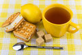 Biscuits sandwiches, cup of tea, lemon and sugar Royalty Free Stock Photo
