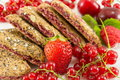 Biscuits with strawberry currant and cherry Royalty Free Stock Photo