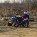 A small boy and his quad which has broken down. Royalty Free Stock Photo