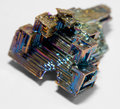 Bismuth crystal a multicolored in light back Stock Photo