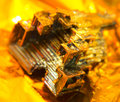 Bismuth crystal a multicolored warm illuminated in golden back Stock Images