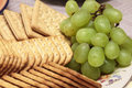 Bisquits and wine grapes Stock Image