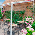 Bistrot with frame external surrounded by flowers Royalty Free Stock Photos